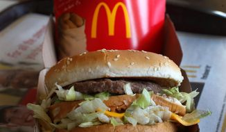 McDonald's, whose regimented production standards and quality consistency were once central to its identity, is struggling to connect with millennials who prefer healthier choices and more personalized options. (Associated Press)