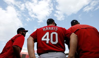 St. Louis Cardinals pitcher Mitch Harris, a 29-year-old graduate of the U.S. Naval Academy, pauses during batting practice before a baseball game against the Washington Nationals at Nationals Park, Tuesday, April 21, 2015, in Washington. Harris was called up from Triple-A Memphis on Tuesday. (AP Photo/Alex Brandon)