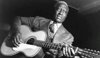 "Huddie William ""Lead Belly"" Ledbetter, with his 12-string guitar, inspired Bob Dylan and Kurt Cobain."