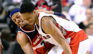 Paul Pierce's (left) intangible contributions have led to an apparent sense of greater confidence by the Wizards in this first-round series. (Frank Gunn/The Canadian Press via Associated Press)