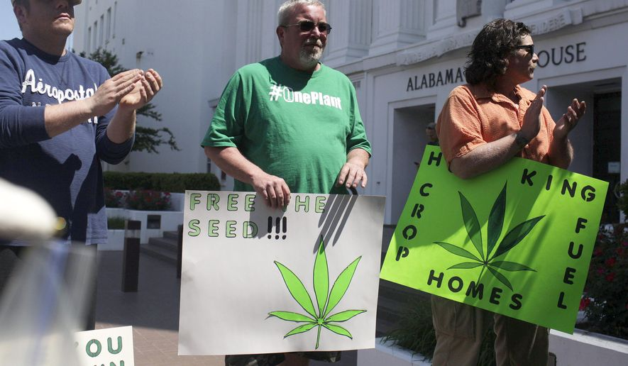 Residents of Alabama stand outside of the state house in favor of medicinal marijuana legalization at a rally, Wednesday, April 22, 2015, in Montgomery, Ala. The Senate Judiciary Committee will hear arguments for and against legalizing medicinal marijuana. The legislation would allow patients with certain medical conditions to buy and even grow a small amount of marijuana each month. (AP Photo/Brynn Anderson)