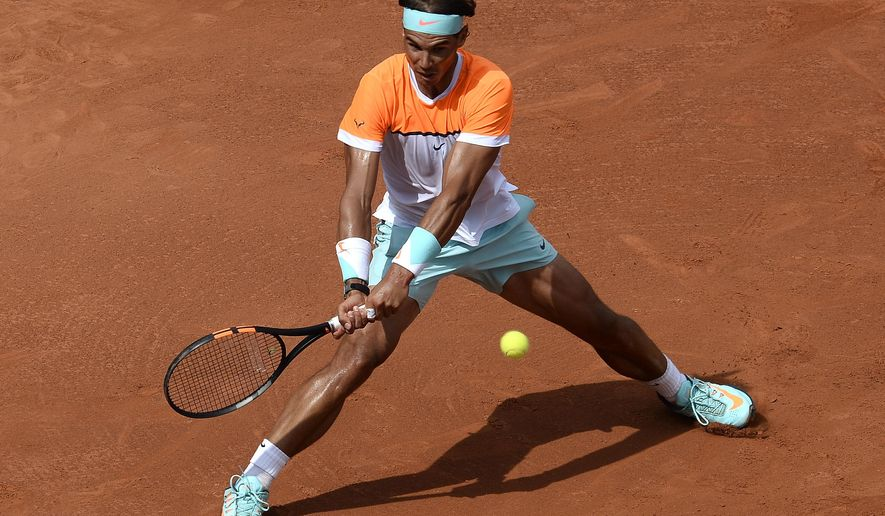 Rafael Nadal of Spain returns the ball to Nicolas Almagro, during the Barcelona open tennis in Barcelona, Spain, Wednesday, April 22, 2015. (AP Photo/Manu Fernandez)