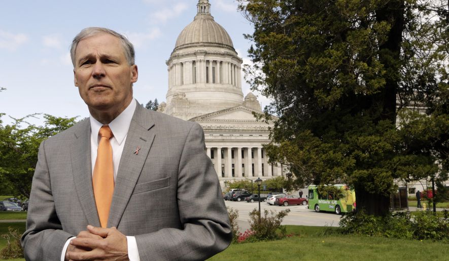 Washington Gov. Jay Inslee talks to the media on Earth Day, Wednesday, April 22, 2015, in Olympia, Wash. Inslee says that the upcoming special session should be used to advance an environment-friendly agenda. Inslee said the extended lawmaking session needs to result in new laws on carbon pollution, oil-train safety and toxic pollutants that show up in the state's fish. (AP Photo/Rachel La Corte)