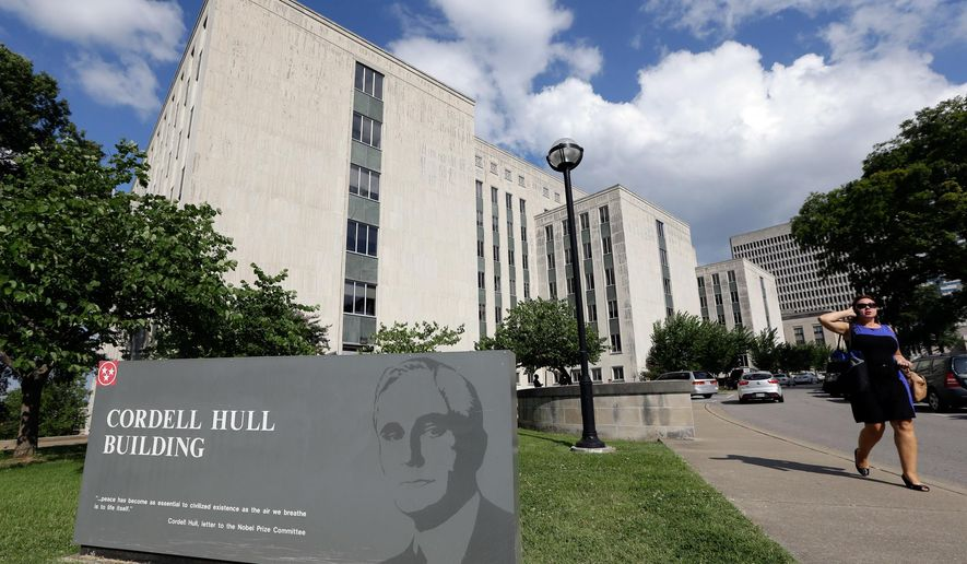 FILE - In this July 2, 2013, file photo, a woman walks past the Cordell Hull Building in Nashville, Tenn. House Speaker Beth Harwell, R-Nashville, said on Wednesday, April 22, 2015, that lawmakers are mulling plans to move their offices from the Legislative Plaza to the building once set for demolition by Gov. Bill Haslam's administration. (AP Photo/Mark Humphrey, file)