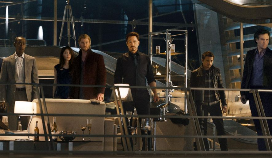 "This photo provided by Disney/Marvel shows, from left, Cobie Smulders, seated, Chris Evans, Don Cheadle, Claudia Kim, Chris Hemsworth, Robert Downey Jr., Jeremy Renner, Mark Ruffalo and Scarlett Johansson in the film, ""Avengers: Age Of Ultron."" The movie releases in U.S. theaters on May 1, 2015. (Disney/Marvel via AP)"