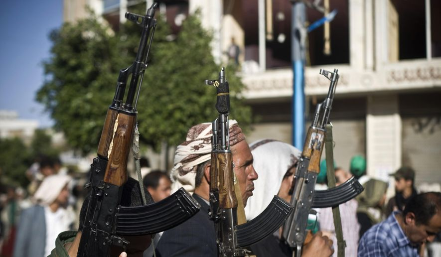 Shiite rebels known as Houthis hold up their weapons during a protest to denounce the Saudi aggression in Sanaa, Yemen, Wednesday, April 22, 2015. Yemen's Shiite rebels, who have taken over large parts of the country and have faced a Saudi-led air assault, said Wednesday they welcome United Nations-led talks to find a political solution to the conflict. (AP Photo/Hani Mohammed)