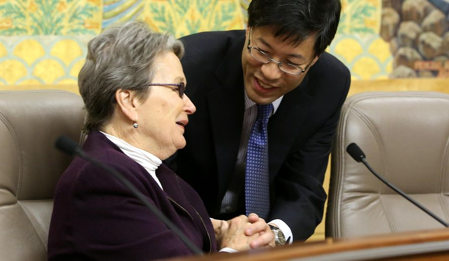 State Sen. Richard Pan, D-Sacramento, thanks Sen. Loni Hancock, D-Berkeley after she joined other members of the Senate Education Committee in approving his measure requiring California schoolchildren to get vaccinated, at the Capitol in Sacramento, Calif., Wednesday, April 22, 2015.  The measure SB277 was approved on a 7-2 vote after amendments were made to the bill that allows families who chose to not vaccinate to homeschool children together and allows independent study. The bill now goes to the Senate Judiciary Committee.  (AP Photo/Rich Pedroncelli)