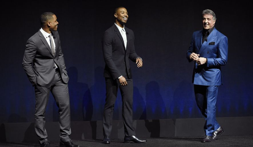 "Ryan Cogler, left, director of the upcoming film ""Creed,"" and cast members Michael B. Jordan, center, and Sylvester Stallone introduce a clip from the film at the Warner Bros. presentation during CinemaCon 2015 at Caesars Palace on Tuesday, April 21, 2015, in Las Vegas. (Photo by Chris Pizzello/Invision/AP)"