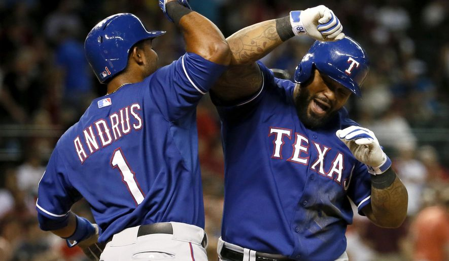 Texas Rangers' Prince Fielder, right, is greeted at home plate by teammate Elvis Andrus after Fielder hit a two-run home run during the eighth inning of a baseball game against the Arizona Diamondbacks, Tuesday, April 21, 2015, in Phoenix. (AP Photo/Matt York)