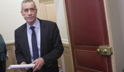 Paris Prosecutor Francois Molins arrives prior to their meeting  with the media in Paris, France, Wednesday April 22, 2015. An Islamic extremist with an arsenal of heavy weapons planned an imminent attack on one or more French churches, France's top security official Molins said Wednesday, announcing the arrest of the man who is also accused in the death of a young mother, Aurelie Chatelain, a 32-year-old Frenchwoman visiting Paris for a training session for her work. (AP Jacques Brinon)
