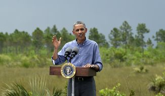 """President Barack Obama speaks about Earth Day while visiting Everglades National Park, Fla., Wednesday, April 22, 2015. Obama visited the Everglades on Earth Day to talk about how global warming threatens the U.S. economy. He says rising sea levels are putting the """"economic engine for the South Florida tourism industry"""" at risk. (AP Photo/Susan Walsh)"""