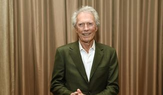 "Filmmaker Clint Eastwood poses for a photo op before ""The Legend of Cinema Luncheon: A Salute to Clint Eastwood"" during CinemaCon 2015 at Caesars Palace on Wednesday, April 22, 2015, in Las Vegas. (Photo by Chris Pizzello/Invision/AP)"