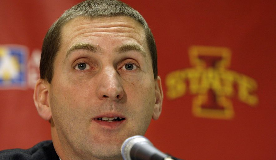 FILE- In this Dec. 15, 2008, file photo, Iowa State athletic director Jamie Pollard speaks about former football coach Gene Chizik during a news conference at Iowa State University in Ames, Iowa.  Pollard is back to work just a month after suffering a heart attack and is expected to meet with the media on Wednesday, April 22, 2015. (AP Photo/Charlie Neibergall, File