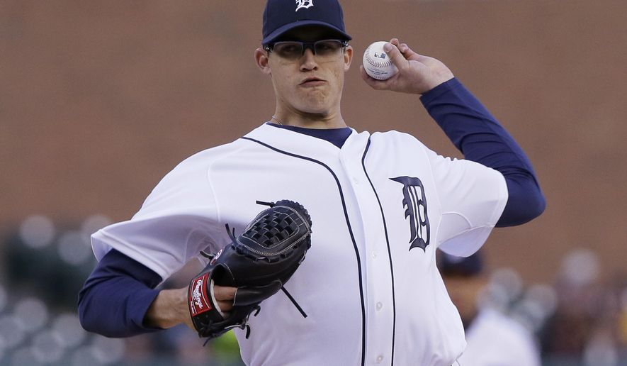 Detroit Tigers starting pitcher Kyle Lobstein throws during the first inning of a baseball game against the New York Yankees, Tuesday, April 21, 2015, in Detroit. (AP Photo/Carlos Osorio)