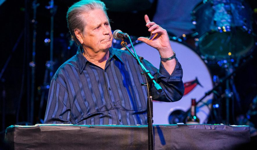 "FILE - In this March 30, 2015 file photo, Brian Wilson performs on stage during Brian Fest: A Night To Celebrate The Music Of Brian Wilson at the Fonda Theatre in Los Angeles. Wilson recently released ""No Pier Pressure."" For his eleventh solo album, he was able to attract young recording artists like Kasey Musgraves, Nate Ruess and Zoey Deschanel and M. Ward, known as She & Him.  (Photo by Paul A. Hebert/Invision/AP, File)"