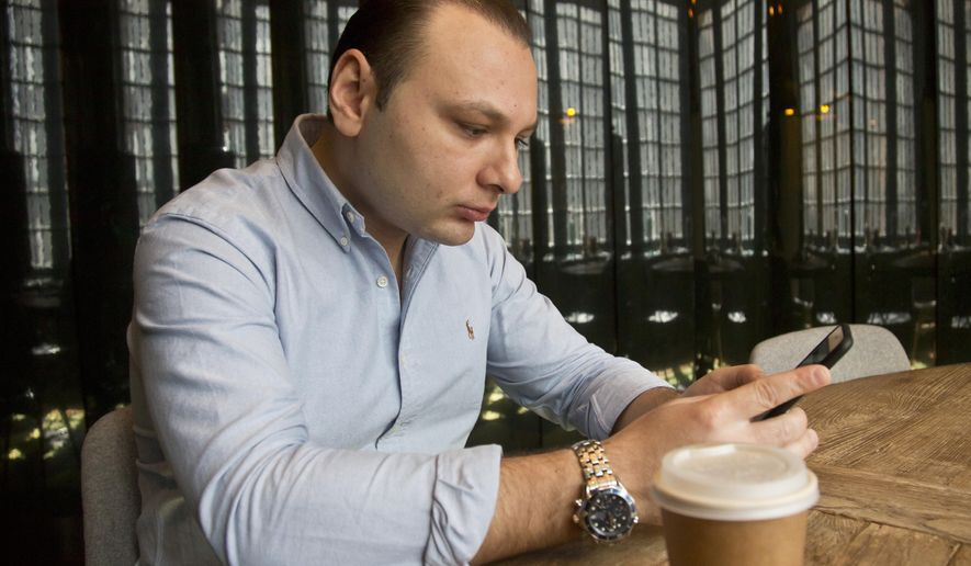 Jacob Tanur, who heads a video production company that employs producers from abroad, reads his phone messages in a conference room, Wednesday, April 15, 2015, in New York.  Companies like Tanur's are finding it difficult to get visa's for talent they want to hire from other countries.  (AP Photo/Bebeto Matthews)
