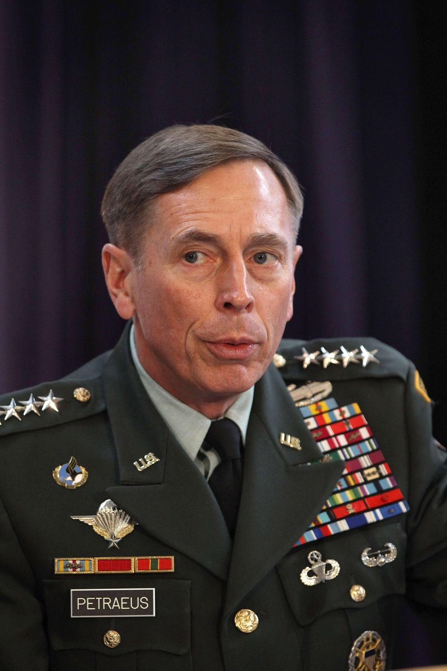 """In this Friday Oct. 15, 2010, file photo, Gen. David Petraeus, the top U.S and NATO commander addresses RUSI members on """"The International Mission in Afghanistan,"""" at the United Services Institute in central London. Former CIA Director Petraeus, whose career was destroyed by an extramarital affair with his biographer, was expected to be sentenced Thursday April 23, 2015 in federal court in Charlotte for giving her classified material while she was working on the book. (AP Photo/Dan Kitwood, Pool, File)"""