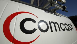 This photo shows the Comcast logo on one of the company's vehicles in Pittsburgh. (AP Photo/Gene J. Puskar, File)