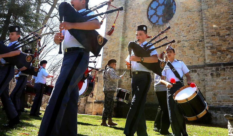 ADVANCE FOR RELEASE MONDAY, APRIL 27, 2015 Members of the St. John's Northwestern Military Academy bagpipe and drum band rehearse marching steps on the campus of the school in Delafield, Wis. Thursday, April 16, 2015. (John Hart/ Wisconsin State Journal via AP)