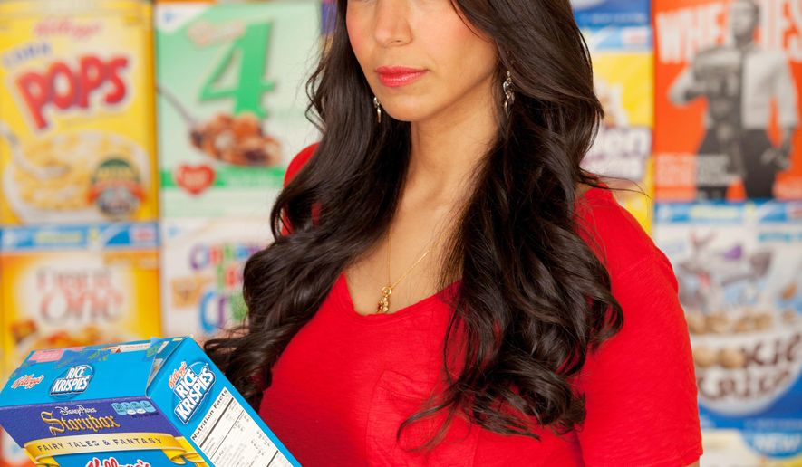 This image released by Vani Hari shows the food blogger among boxes of cereal in Charlotte, N.C. The former management consultant turned healthy-living activist has a best-selling book and an army of supporters. She deploys them regularly to move giants in the food industry via online petitions that, among other things, helped get Kraft Foods to give up artificial dyes in its macaroni and cheese. (Courtesy Vani Hari via AP)