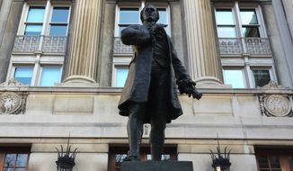 "This Jan. 16, 2015 photo shows a statue of Alexander Hamilton outside Hamilton Hall on the campus of Columbia University in New York City. Columbia was founded as King's College, which Hamilton attended before going off to fight in the Revolutionary War. He rose to become George Washington's right-hand man, a story told in a new musical, ""Hamilton,"" that just opened off-Broadway. (AP Photo/Eric Carvin)"