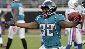 FILE - In this Oct. 3, 2010, file photo, Jacksonville Jaguars running back Maurice Jones-Drew celebrates a fourth-quarter touchdown against the Indianapolis Colts during an NFL football game in Jacksonville, Fla. The Jaguars announced Thursday, April 23, 2015, that Jones-Drew will sign a ceremonial, one-day contract on Tuesday before officially retiring.  Jones-Drew called it quits last month after nine NFL seasons. (AP Photo/John Raoux, File)