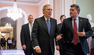 Senate Majority Leader Mitch McConnell of Ky., center, and Sen. Cory Gardner, R-Colo., right,  head into the Senate Chamber on Cap[itol Hill in Washington, Thursday, April 23, 2015, for the confirmation vote on the nomination of Loretta Lynch for Attorney General. Lynch won confirmation to serve as attorney general Thursday from a Senate that forced her to wait more than five months for the title and remained divided to the end.  (AP Photo/Andrew Harnik)