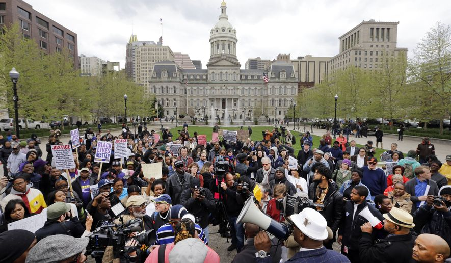 Protestors gather outside of Baltimore's City Hall before a march for Freddie Gray, Thursday, April 23, 2015, in Baltimore. Gray died from spinal injuries about a week after he was arrested and transported in a police van. (AP Photo/Patrick Semansky)