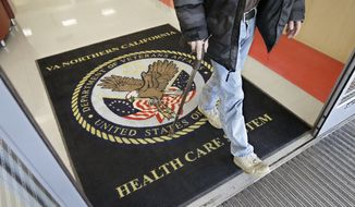 FILE - In this April 2, 2015, file photo, a visitor leaves the Sacramento Veterans Affairs Medical Center in Rancho Cordova, Calif. A new program that was supposed to get patients off waiting lists at Veterans Affairs medical centers by letting them switch to private-sector doctors is proving to be an even bigger disappointment than initially thought. (AP Photo/Rich Pedroncelli, File)