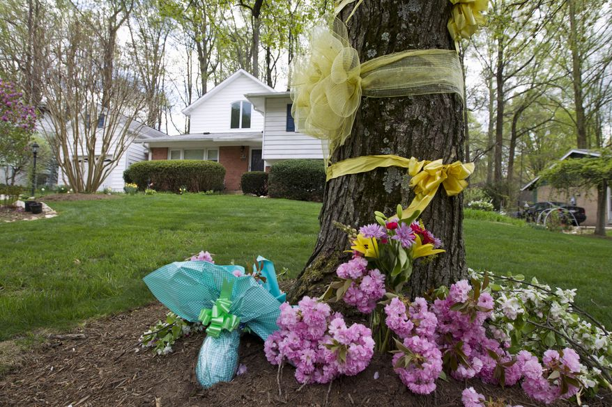 """Flowers and ribbons adorn a tree outside the Weinstein familyhouse in Rockville, Md., Thursday, April 23, 2015. Earlier, President Barack Obama took full responsibility for the counterterror missions and offered his """"grief and condolences"""" to the families of the hostages, Warren Weinstein of Rockville, Maryland, and Giovanni Lo Porto who were inadvertently killed by CIA drone strikes early this year.  (AP Photo/Jose Luis Magana)"""