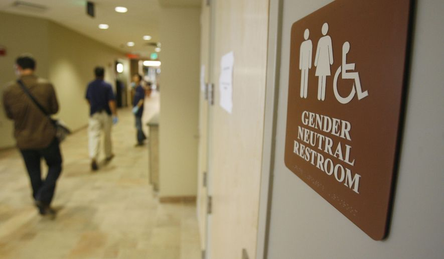 A sign marks the entrance to a gender neutral restroom at the University of Vermont in Burlington, Vt. (Associated Press) **FILE**