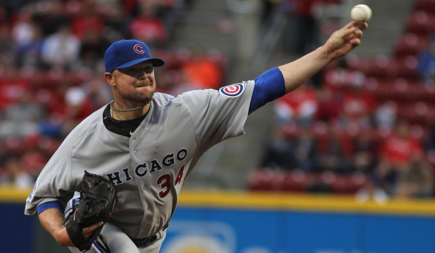 Chicago Cubs' Jon Lester pitches against the Cincinnati Reds during the first inning of a baseball game Friday, April 24, 2015, in Cincinnati. (AP Photo/Tom Uhlman)