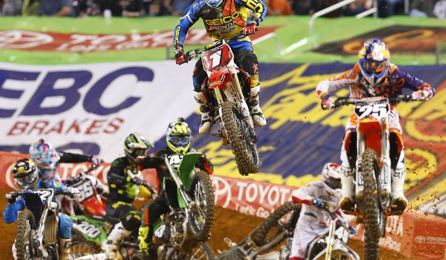 FILE - In this Feb. 14, 2015, file photo, Supercross riders Marvin Musquin (25) and Justin Bogle (1) lead the race in the first lap during the Monster Energy AMA Supercross 250SX Final at AT &T Stadium in Arlington, Texas. Having this weekend's Supercross race in Detroit shown live on a major network should help the sport pick up some steam. Tom Fox/The Dallas Morning News via AP, File) MANDATORY CREDIT; MAGS OUT; TV OUT; INTERNET USE BY AP MEMBERS ONLY; NO SALES