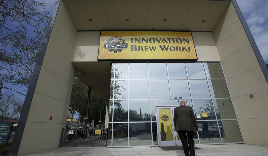 In this Thursday, March 19, 2015, photo, Associated Dean Michael Godfrey tours the newly build Innovation Brew Works at the California State Polytechnic University, Pomona in Pomona, Calif. Godfrey, who brought brew studies to Cal Poly in 2000 with a single class on the culture and history of beer, envisions Innovation Brew Works eventually becoming the centerpiece of studies for chemistry students interested in learning the complicated science of making good-tasting beer, as well as for hospitality students interested in marketing beer. (AP Photo/Damian Dovarganes)