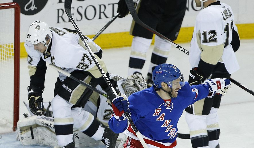 New York Rangers center Dominic Moore (28) reacts after left wing Carl Hagelin scored the winning goal in overtime of Game 5 against the Pittsburgh Penguins in the first round of the NHL hockey Stanley Cup playoffs, Friday, April 24, 2015, in New York. The Rangers won 2-1 to advance to the second round. (AP Photo/Julie Jacobson)