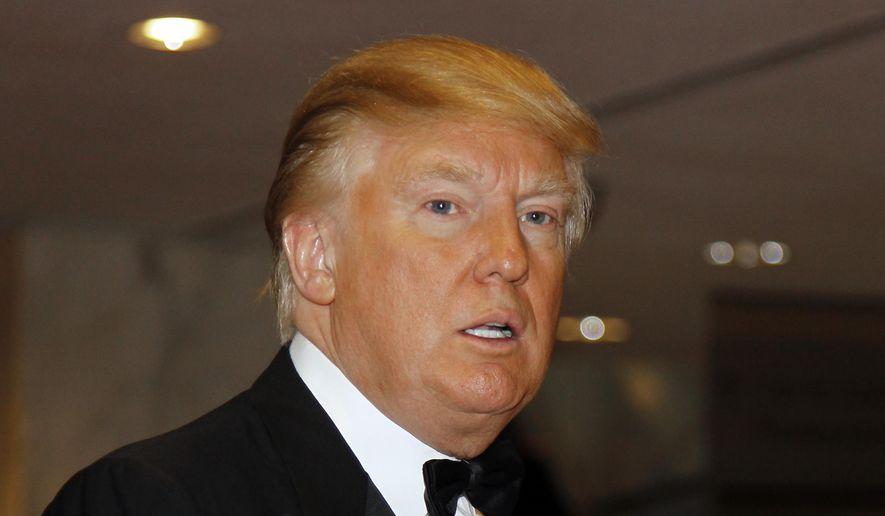 In this April 30, 2011, file photo, Donald Trump arrives for the White House Correspondents Dinner  in Washington. (AP Photo/Alex Brandon, File)