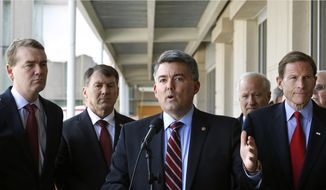 Sen. Cory Gardner, R-Colo., speaks to members of the media following a U.S. Senate delegation tour of the over-budget Veterans Administration hospital complex, which is under construction, in Aurora, Colo. (AP Photo/Brennan Linsley)
