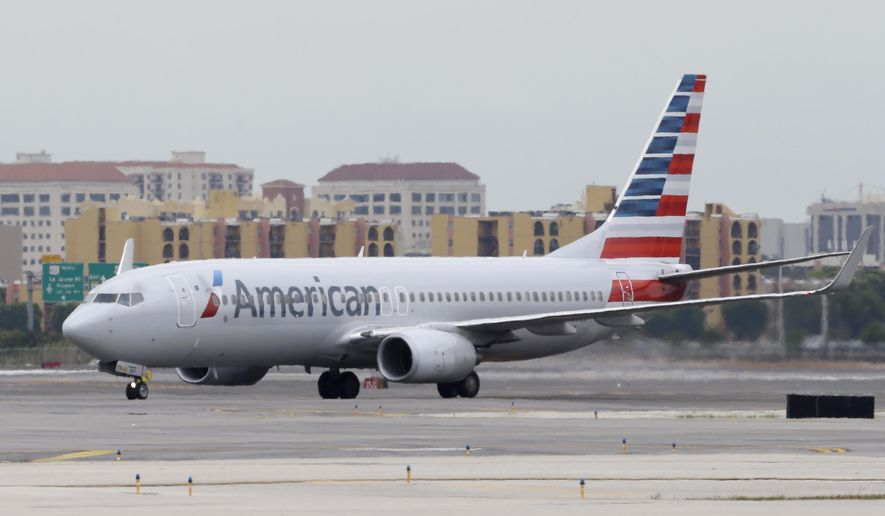In this Wednesday, April 22, 2015, photo, an American Airlines Boeing 737 taxis before taking off at Miami International Airport in Miami. American Airlines reports earnings Friday April 24, 2015. (AP Photo/Wilfredo Lee) ** FILE **