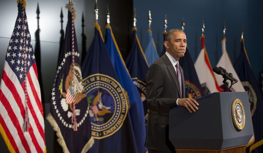 President Barack Obama pauses while speaking at the Office of the Director of National Intelligence's (ODNI) 10th anniversary at ODNI headquarters in McLean, Va., Friday, April 24, 2015. The president told members of the intelligence community that he appreciates their service and understands they don't take their work lightly. (AP Photo/Pablo Martinez Monsivais)