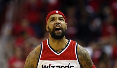 Washington Wizards forward Drew Gooden (90) celebrates during the first half of Game 3 in the first round of the NBA basketball playoffs against the Toronto Raptors, Friday, April 24, 2015, in Washington. (AP Photo/Alex Brandon) **FILE**