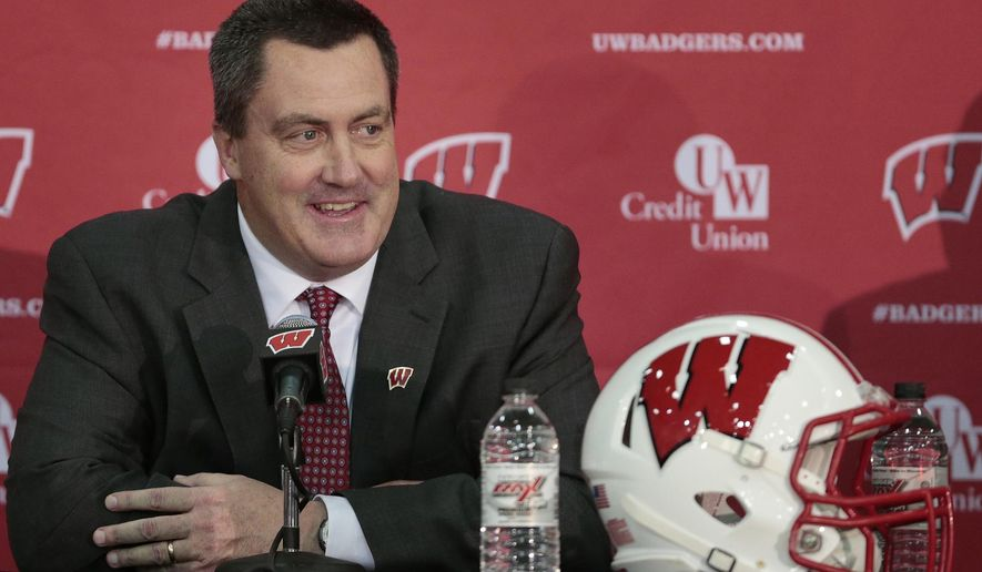 FILE - In this Dec. 17, 2014, file phtoo, Paul Chryst, Wisconsin's new football coach, speaks during an a NCAA college football news conference at the Nicholas-Johnson Pavilion in Madison, Wis. For all the talk about Wisconsin's offense under new coach Paul Chryst, the defense could have a few new wrinkles too. Linebackers Vince Biegel and Joe Schobert are looking forward to showing off some tweaks at Saturday's spring game. (AP Photo/Wisconsin State Journal, M.P. King, File)