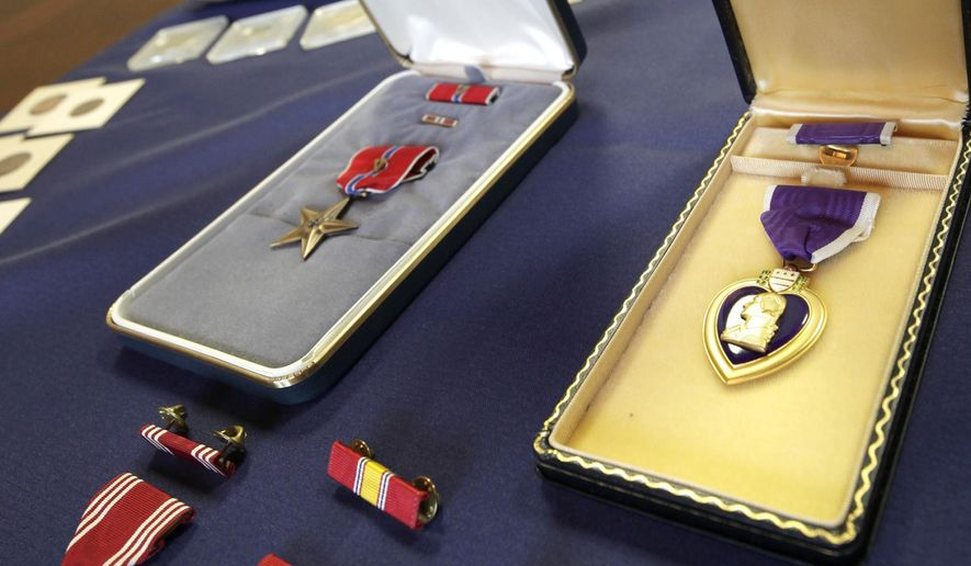 A Bronze Star, top left, Purple Heart, right, and other medals are displayed at the Auditor of State's office in Little Rock, Ark., Friday, April 24, 2015. (AP Photo/Danny Johnston) ** FILE **