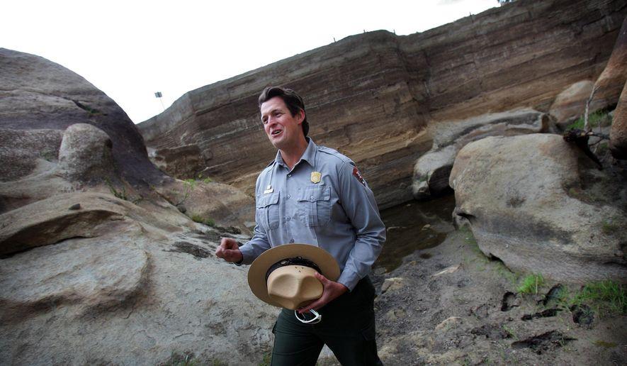 Ranger Jay Theuer stands at Barker Dam in Joshua Tree National Park. (Kurt Miller/The Press-Enterprise via AP)