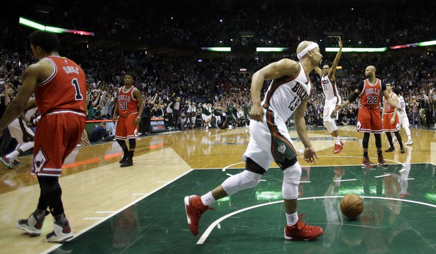 Milwaukee Bucks' Jerryd Bayless (19) reacts after making the game-winning basket during the second half of Game 4 of an NBA basketball first-round playoff series against the Chicago Bulls, Saturday, April 25, 2015, in Milwaukee. The Bucks won 92-90. (AP Photo/Morry Gash)