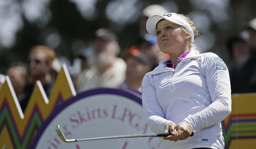 Brooke Henderson of Canada follows her shot from the third tee of the Lake Merced Golf Club during the third round of the Swinging Skirts LPGA Classic golf tournament Saturday, April 25, 2015, in Daly City, Calif. (AP Photo/Eric Risberg)