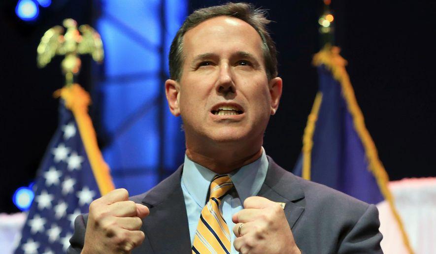 Former Pennsylvania Sen. Rick Santorum speaks at the Iowa Faith & Freedom 15th Annual Spring Kick Off, in Waukee, Iowa, Saturday, April 25, 2015. (AP Photo/Nati Harnik)