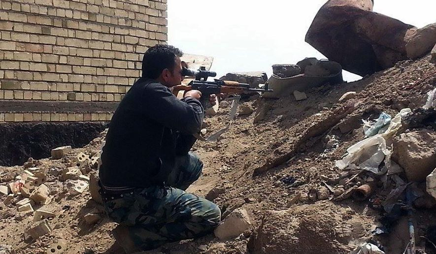CLARIFYING IDENTITY OF MAN. A member of the Iraqi security forces aims his weapon to attack Islamic State group militants on al-Houz bridge on the Euphrates river in Ramadi, 70 miles (115 kilometers) west of Baghdad, Iraq, Friday, April 24, 2015. Iraqi security forces recaptured a key bridge from Islamic militants in the capital of western Anbar on Friday, said an Iraqi security official, as top Shiite cleric renewed calls for national unity among political groups in the face of Islamic militant group. (AP Photo)