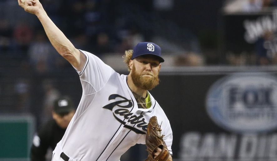 San Diego Padres starting pitcher Andrew Cashner works against the Los Angeles Dodgers in the first inning of a baseball game Friday, April 24, 2015 in San Diego.   (AP Photo/Lenny Ignelzi))