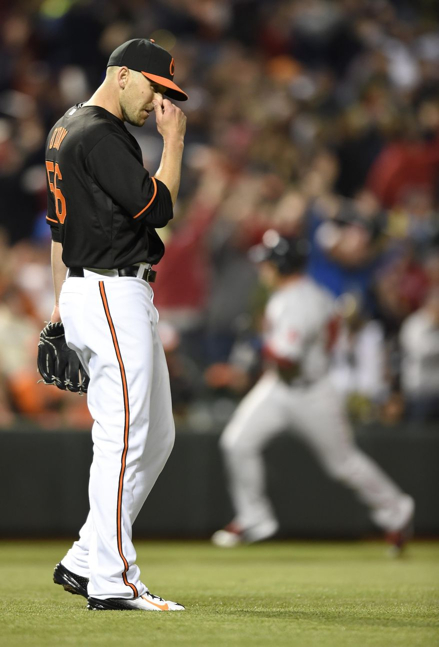 Baltimore Orioles pitcher Darren O'Day walks to the mound after giving up a three-run home run to the Boston Red Sox during the eighth inning of a baseball game, Friday, April 24, 2015, in Baltimore. The Red Sox won 7-5. (AP Photo/Gail Burton)