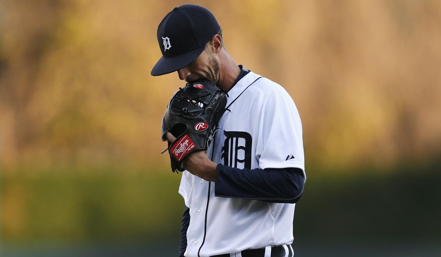 Detroit Tigers pitcher Shane Greene walks to the dugout in the first inning of a baseball game against the Cleveland Indians in Detroit, Friday, April 24, 2015. (AP Photo/Paul Sancya)